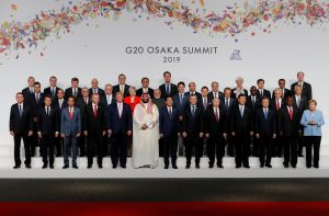 Japanese Prime Minister Shinzo Abe, other leaders and delegates attend a family photo session at G20 leaders summit in Osaka, Japan, June 28, 2019. REUTERS/Kim Kyung-Hoon/Pool