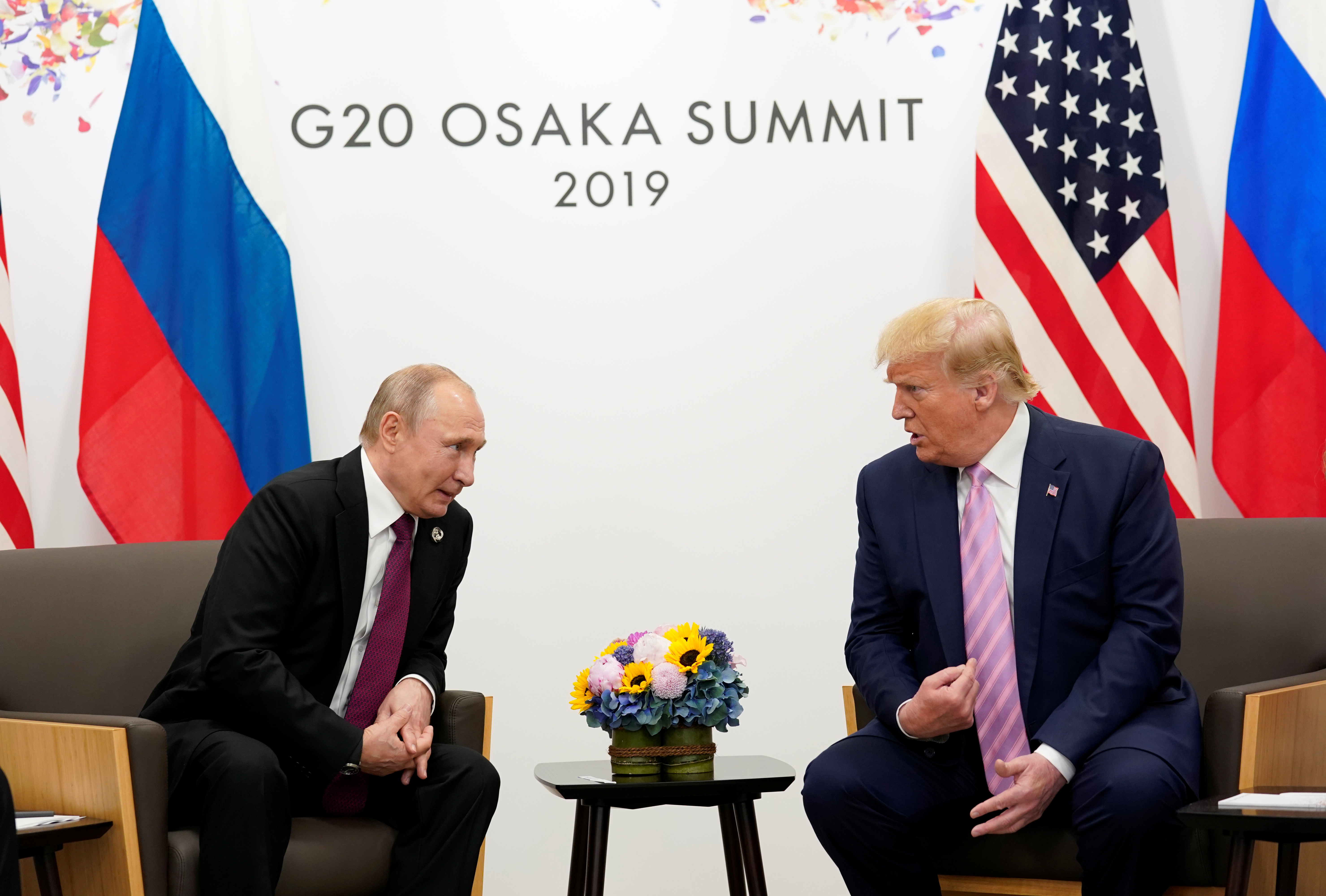 Russia's President Vladimir Putin and U.S. President Donald Trump talk during a bilateral meeting at the G20 leaders summit in Osaka, Japan, June 28, 2019. REUTERS/Kevin Lamarque