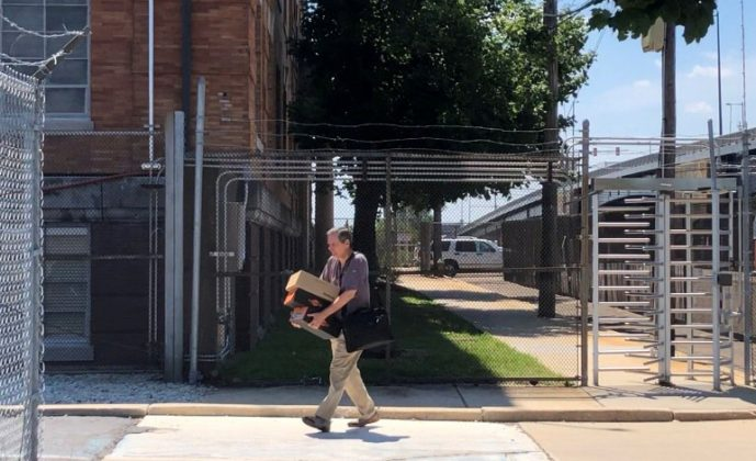 FILE PHOTO: A worker leaves the Philadelphia Energy Solutions oil refinery carrying personal items, after employees were told the complex would shut down following a recent fire that caused significant damage, in Philadelphia, Pennsylvania, U.S., June 26, 2019. REUTERS/Laila Kearney/File Photo
