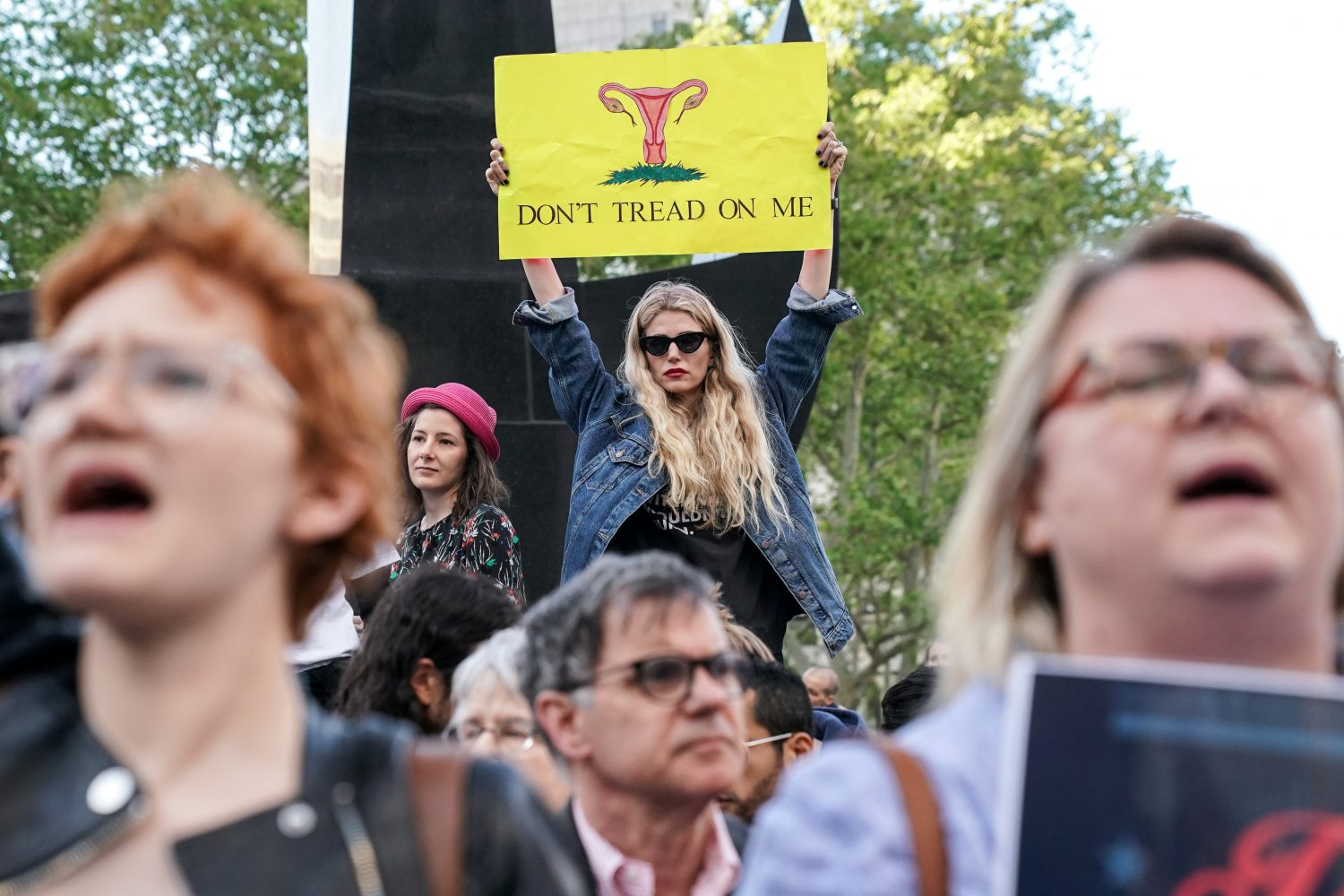 FILE PHOTO: Abortion-rights campaigners attend a rally against new restrictions on abortion passed by legislatures in eight states including Alabama and Georgia, in New York City, U.S., May 21, 2019. REUTERS/Jeenah Moon