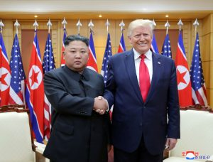 U.S. President Donald Trump shakes hands with North Korean leader Kim Jong Un as they meet at the demilitarized zone separating the two Koreas, in Panmunjom, South Korea, June 30, 2019. KCNA via REUTERS