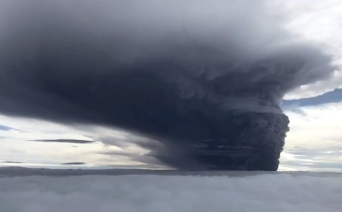 FILE PHOTO - Ash billows from Mount Ulawun during a volcanic eruption, West New Britain, Papua New Guinea June 26, 2019 in this still image taken from social media video. Eroli Tamara via REUTERS