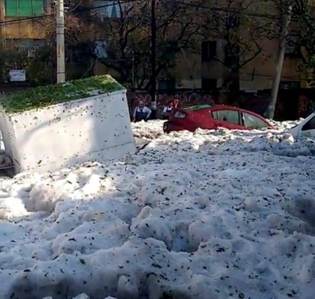 A street covered in ice is pictured after a heavy storm of rain and hail in Guadalajara, Mexico June 30, 2019, in this picture grab obtained from a social media video. Picture taken June 30, 2019. Jorge David Arias Flores/via REUTERS