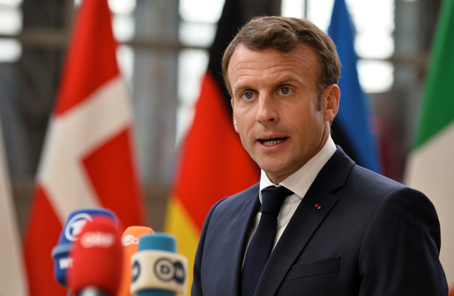 FILE PHOTO - French President Emmanuel Macron speaks to the media ahead of a European Union leaders summit that aims to select candidates for top EU institution jobs, in Brussels, Belgium June 30, 2019. REUTERS/Johanna Geron