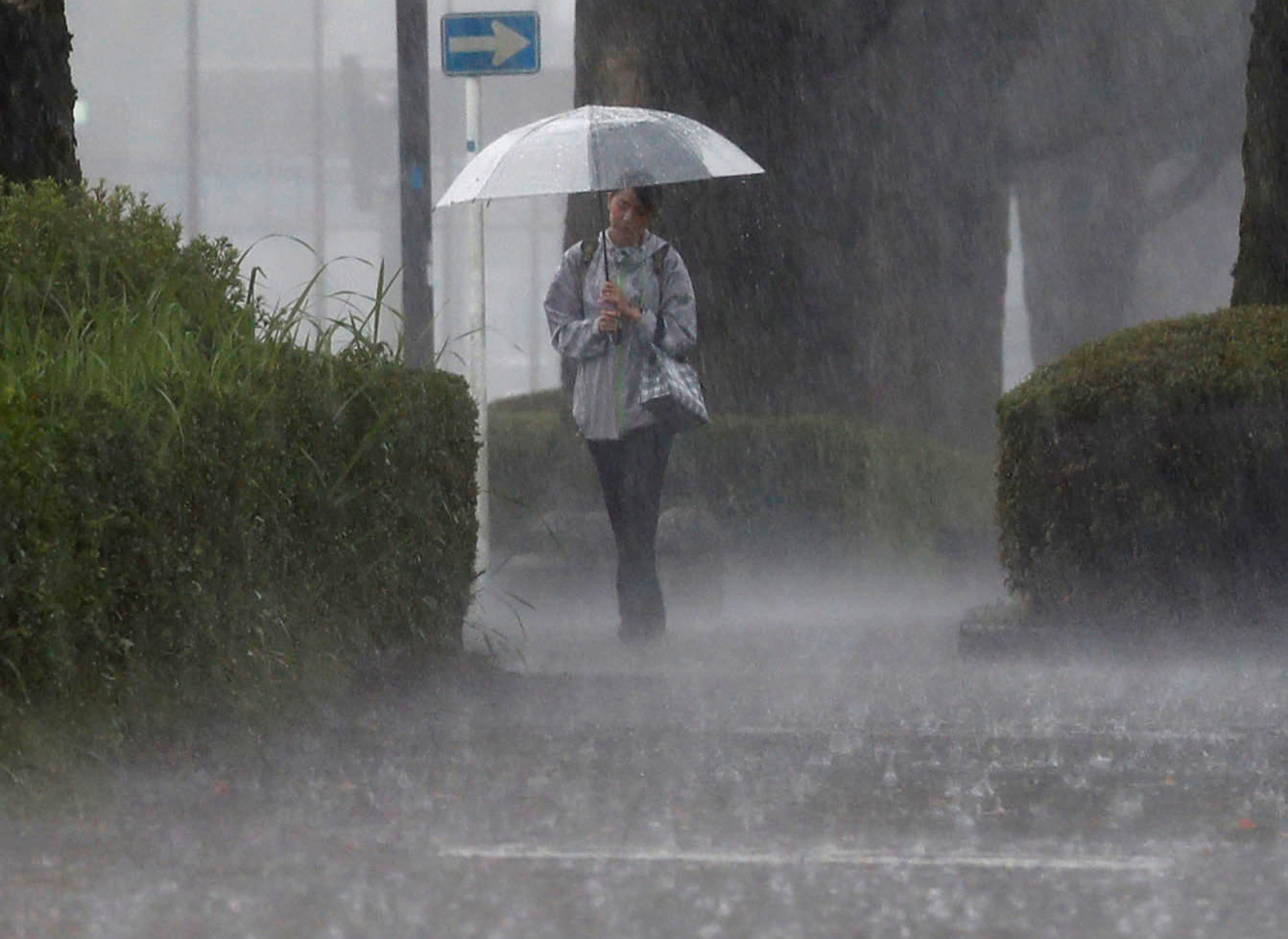 A pedestrian walks through heavy rain in Kirishima, Kagoshima Prefecture, southwestern Japan, July 3, 2019, in this photo taken by Kyodo. Mandatory credit Kyodo/via REUTERS ATTENTION EDITORS - THIS IMAGE WAS PROVIDED BY A THIRD PARTY. MANDATORY CREDIT. JAPAN OUT. NO COMMERCIAL OR EDITORIAL SALES IN JAPAN. THIS IMAGE WAS PROCESSED BY REUTERS TO ENHANCE QUALITY, AN UNPROCESSED VERSION HAS BEEN PROVIDED SEPARATELY.