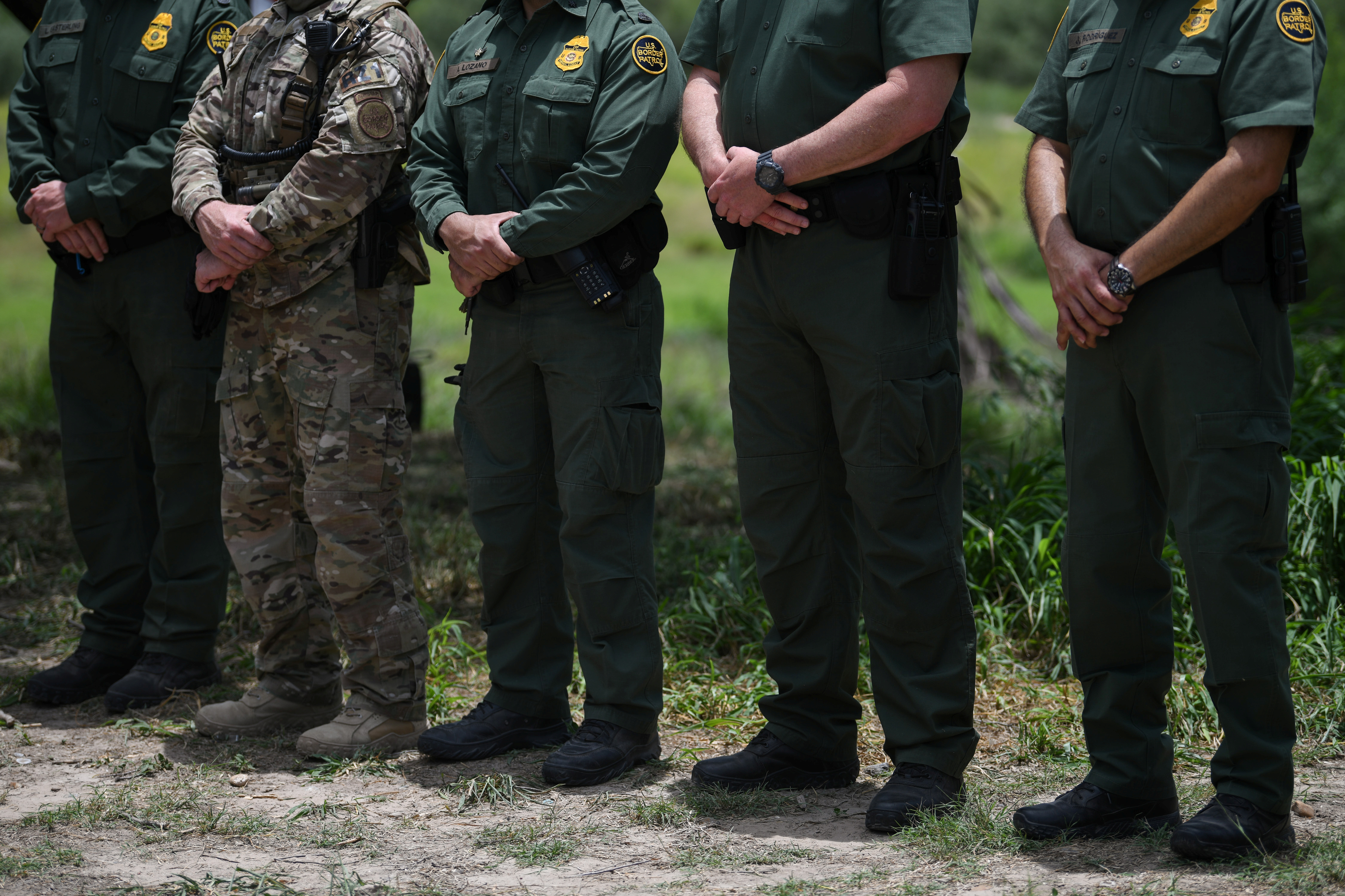 U.S. Border Patrol agents stand at attention during a 'Border Safety Initiative' media event at the U.S.-Mexico border in Mission, Texas, U.S., July 1, 2019. REUTERS/Loren Elliott
