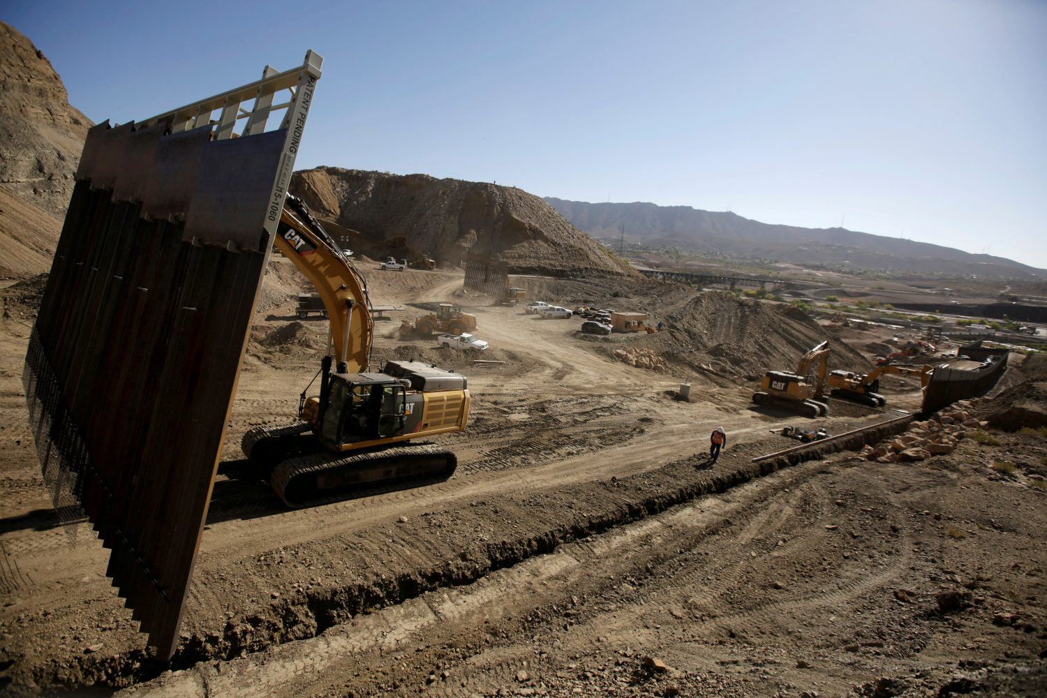 FILE PHOTO: Heavy machinery moves a bollard-type wall, to be placed along the border of private property using funds raised from a GoFundMe account, at Sunland Park, N.M., as seen from Ciudad Juarez, Mexico May 27, 2019. REUTERS/Jose Luis Gonzalez/File Photo