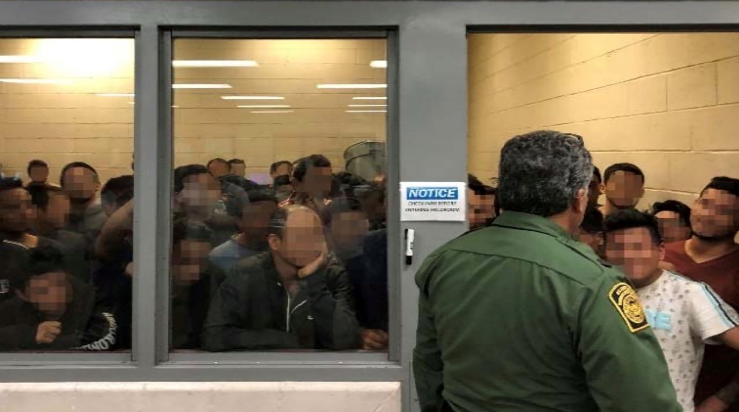 FILE PHOTO: Men are crowded in a room at a Border Patrol station in a still image from video in McAllen, Texas, U.S. on June 10, 2019 and released as part of a report by the Department of Homeland Security's Office of Inspector General on July 2, 2019. Picture pixelated at source. Office of Inspector General/DHS/Handout via REUTERS./File Photo