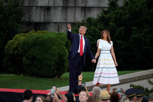"""U.S. President Donald Trump and first lady Melania Trump react as they arrive for the """"Salute to America"""" event during Fourth of July Independence Day celebrations at the Lincoln Memorial in Washington, D.C., U.S., July 4, 2019. REUTERS/Carlos Barria"""