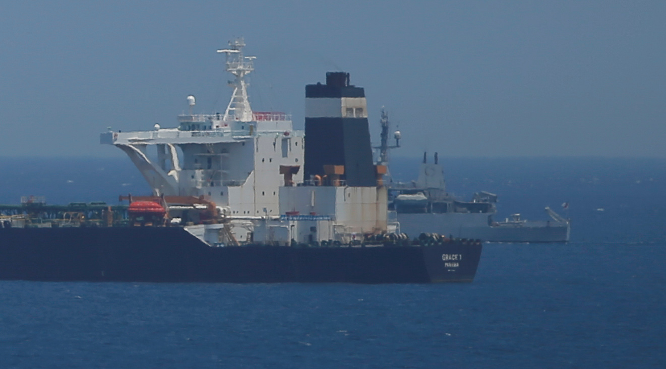 A British Royal Navy patrol vessel guards the oil supertanker Grace 1, that's on suspicion of carrying Iranian crude oil to Syria, as it sits anchored in waters of the British overseas territory of Gibraltar, historically claimed by Spain, July 4, 2019. REUTERS/Jon Nazca