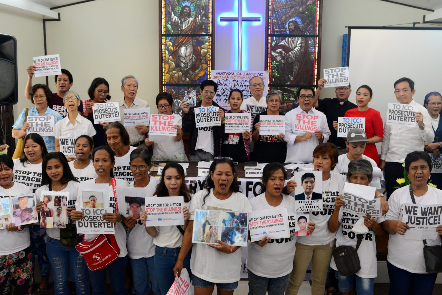 FILE PHOTO: Activists and families of drug war victims display placards during a protest against the war on drugs by President Rodrigo Duterte in Quezon city, Metro Manila in Philippines, August 28, 2018. REUTERS/Eloisa Lopez