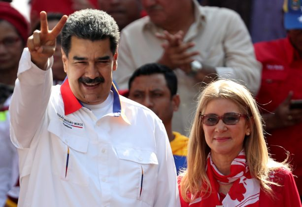 FILE PHOTO: Venezuela's President Nicolas Maduro greets people next to his wife Cilia Flores during a rally in support of the government in Caracas, Venezuela May 20, 2019. REUTERS/Ivan Alvarado/File Photo