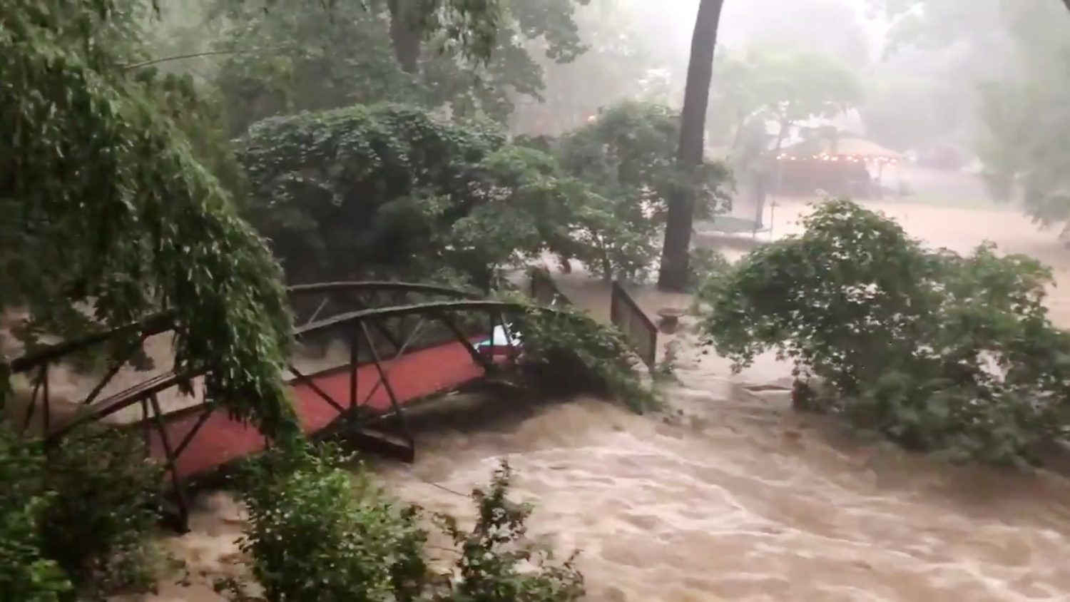 Flood waters are pictured in North Arlington, Virginia, U.S., July 8, 2019 in this picture grab obtained from social media video. Twitter/Hope Hodge Seck/@hopeseck/via REUTERS