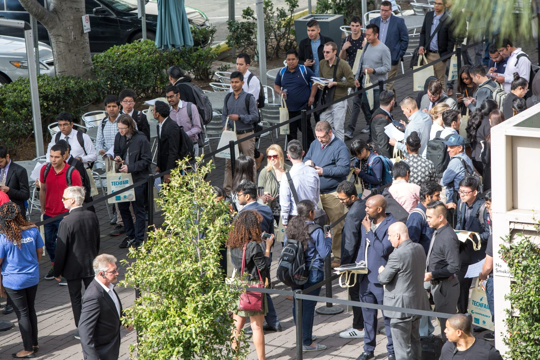 FILE PHOTO: Job seekers line up at TechFair in Los Angeles, California, U.S. March 8, 2018. REUTERS/Monica Almeida