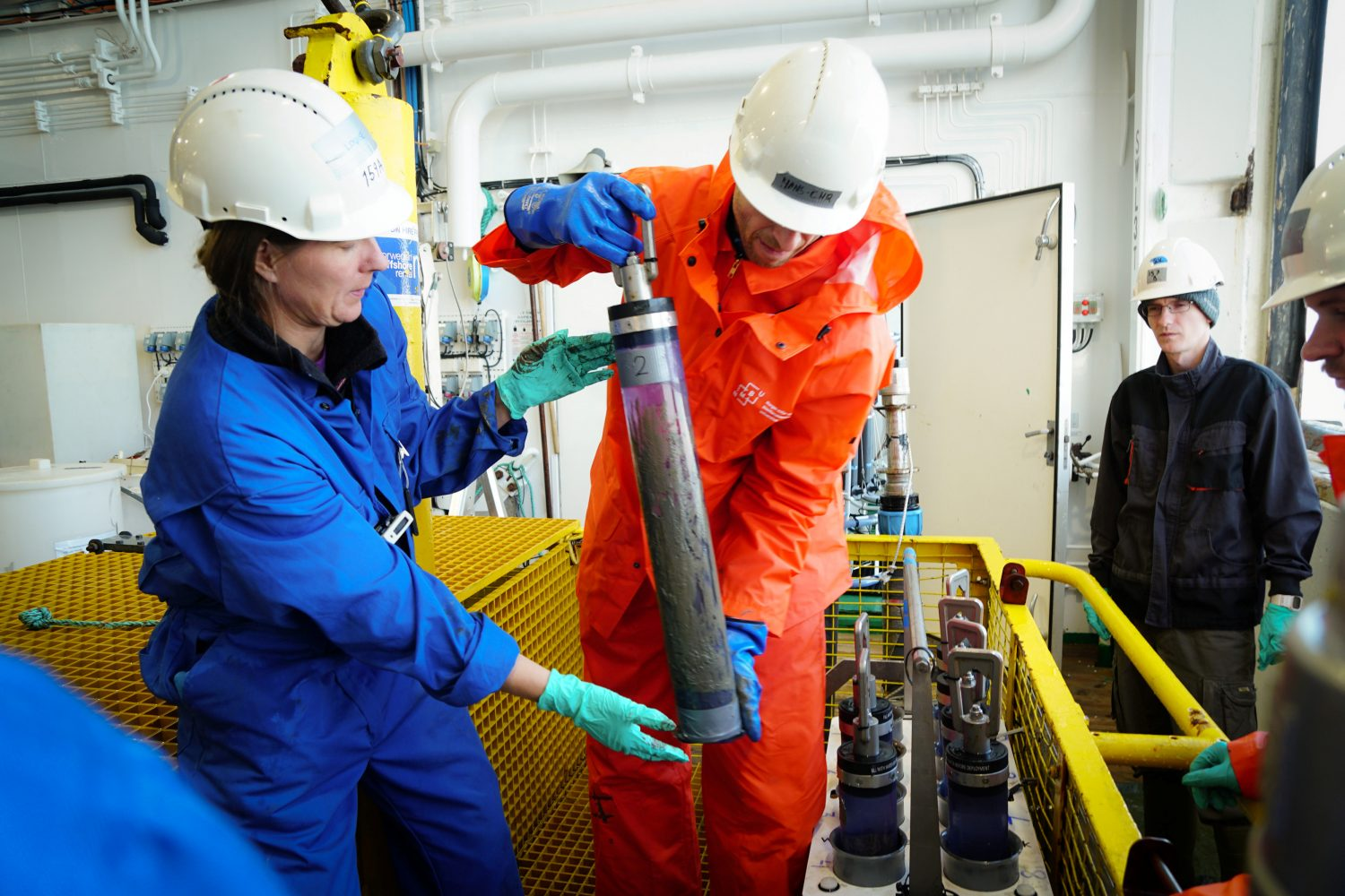 "Louise Kiel Jensen (DSA) and Hans-Christian Teien (NMBU) take samples from the Soviet nuclear submarine ""Komsomolets"", to be analyzed for radioactive substances, southwest of Bear Island in the Norwegian Arctic, Norway in this handout image released on July 10, 2019. Stine Hommedal/Norwegian Institute of Marine Research/HI/Handout via REUTERS"
