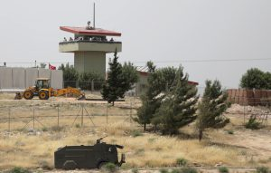 FILE PHOTO: Turkish soldiers stand on a watch tower at the Atmeh crossing on the Syrian-Turkish border, as seen from the Syrian side, in Idlib governorate, Syria May 31, 2019. REUTERS/Khalil Ashawi