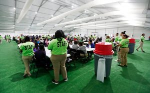 Staff oversee breakfast at the U.S. government's government's newest holding center for migrant children in Carrizo Springs, Texas, U.S. July 9, 2019. Picture taken July 9, 2019. Eric Gay/Pool via REUTERS