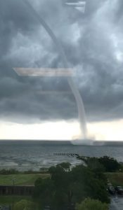 A waterspout is seen on Lake Pontchartrain off New Orleans, Louisiana, U.S. July 10, 2019 in this image obtained from social media. Bryon Callahan via REUTERS