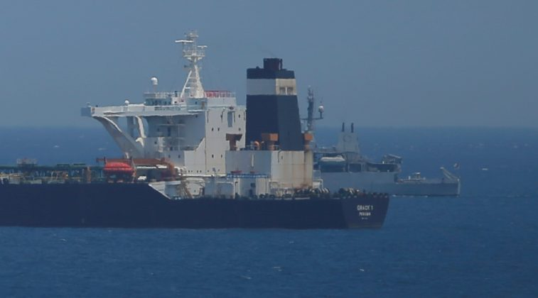 FILE PHOTO: A British Royal Navy patrol vessel guards the oil supertanker Grace 1, suspected of carrying Iranian crude oil to Syria, as it sits anchored in waters of the British overseas territory of Gibraltar, July 4, 2019. REUTERS/Jon Nazca/File Photo