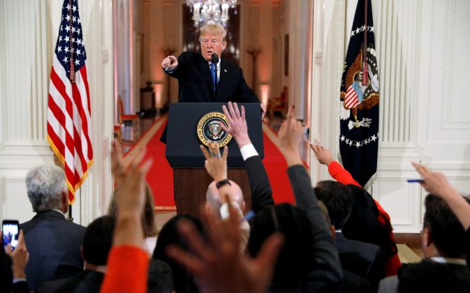 FILE PHOTO: U.S. President Donald Trump points to a questioner while taking questions during a news conference following Tuesday's midterm congressional elections at the White House in Washington, U.S., November 7, 2018. REUTERS/Kevin Lamarque/File Photo
