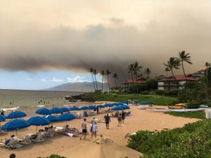 Smoke blankets the sky as a wildfire spreads in Maui, Hawaii, in this July 11, 2019 photo obtained from social media. Roger Norris/via REUTERS
