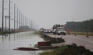 Crews clear debris from Highway 23 during Hurricane Barry in Plaquemines Parish, Louisiana, U.S. July 14, 2019. REUTERS/Jonathan Bachman