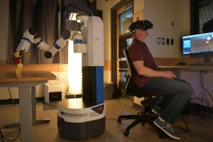 University of Colorado Boulder PhD student Dan Prendergast participates in an experiment to test whether he operates a robot better in 2D or virtual reality at a lab in Boulder, Colorado, U.S., June 24, 2019. The team's findings may help determine what camera systems will be implemented on robots destined to perform tasks on the moon. REUTERS/Michael Ciaglo