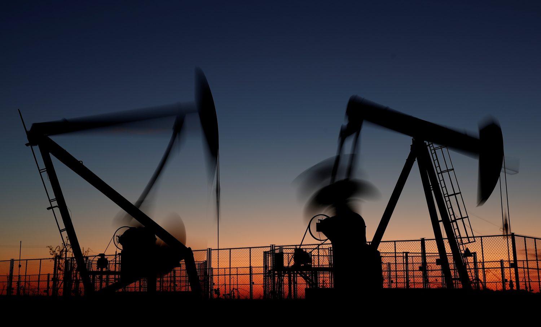 FILE PHOTO: Oil pumps are seen after sunset outside Vaudoy-en-Brie, near Paris, France November 14, 2018. REUTERS/Christian Hartmann