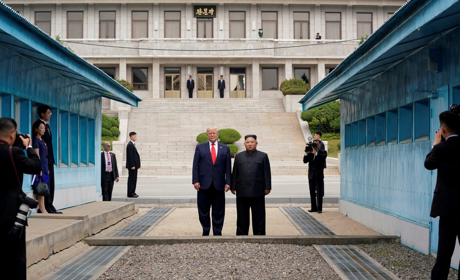 FILE PHOTO: U.S. President Donald Trump and North Korean leader Kim Jong Un stand at the demarcation line in the demilitarized zone separating the two Koreas, in Panmunjom, South Korea, June 30, 2019. REUTERS/Kevin Lamarque/File Photo