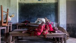 A woman displaced by the recent flood sleeps inside a classroom of Shree Sarsawati Higher Secondary School at Bhalohiya village in Rautahat, Nepal, July 17, 2019. REUTERS/Riwaj Rai