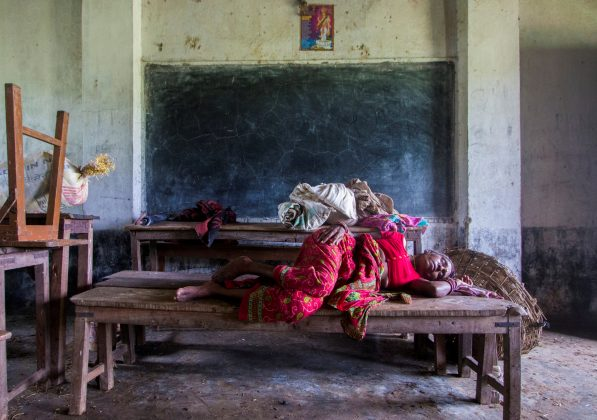 A woman displaced by the recent flood sleeps inside a classroom of Shree Sarsawati Higher Secondary School at Bhalohiya village in Rautahat, Nepal, July 17, 2019. REUTERS/Riwaj Rai