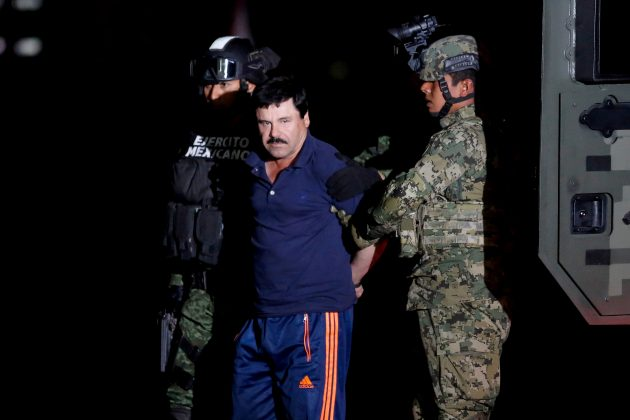 "FILE PHOTO: Joaquin ""El Chapo"" Guzman is escorted by soldiers during a presentation in Mexico City, January 8, 2016. REUTERS/Tomas Bravo"