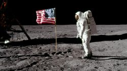 Astronaut Buzz Aldrin, lunar module pilot for Apollo 11, poses for a photograph beside the deployed United States flag during an extravehicular activity (EVA) on the moon, July 20, 1969. The lunar module (LM) is on the left, and the footprints of the astronauts are visible in the soil. Neil Armstrong/NASA/Handout via REUTERS
