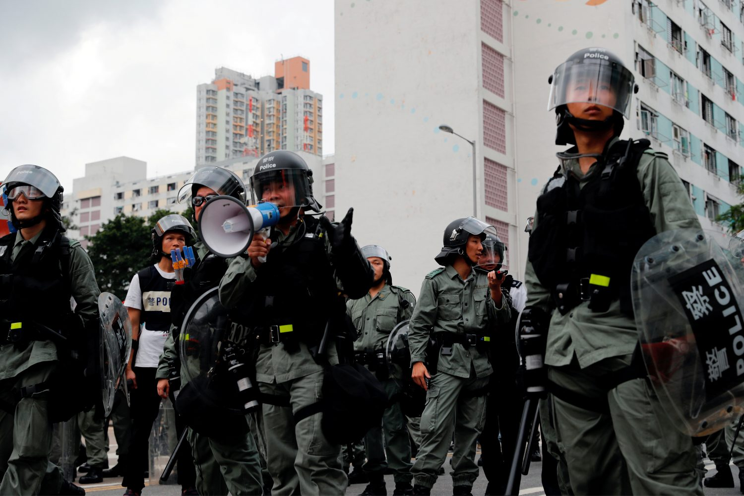 FILE PHOTO: Riot police ask anti-extradition bill protesters to leave in front of public housing after a march at Sha Tin District of East New Territories, Hong Kong, China July 14, 2019. REUTERS/Tyrone Siu/File Photo