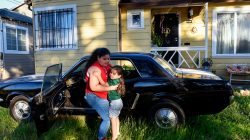 Ashley Avila, 11, plays with her nephew Alexander Avila, 3, outside of their home where Alexander was lead poisoned by lead-based paint in Oakland, California, U.S. June 18, 2019. REUTERS/Kate Munsch