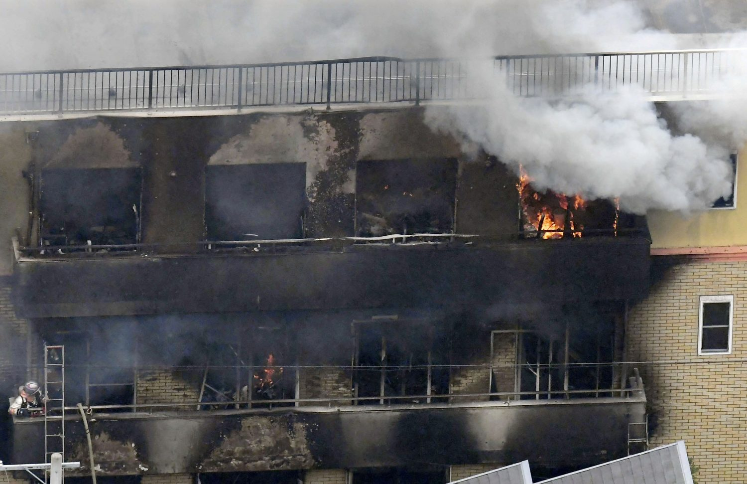 An aerial view shows smoke and flame rise from the three-story Kyoto Animation building which was torched in Kyoto, western Japan, in this photo taken by Kyodo July 18, 2019. Mandatory credit Kyodo/via REUTERS ATTENTION EDITORS - THIS IMAGE WAS PROVIDED BY A THIRD PARTY. MANDATORY CREDIT. JAPAN OUT. NO COMMERCIAL OR EDITORIAL SALES IN JAPAN.