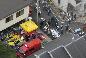 Rescue workers carry injured people from the three-story Kyoto Animation building which was torched in Kyoto, western Japan, in this photo taken by Kyodo July 18, 2019. Mandatory credit Kyodo/via REUTERS ATTENTION EDITORS - THIS IMAGE WAS PROVIDED BY A THIRD PARTY. MANDATORY CREDIT. JAPAN OUT. NO COMMERCIAL OR EDITORIAL SALES IN JAPAN.