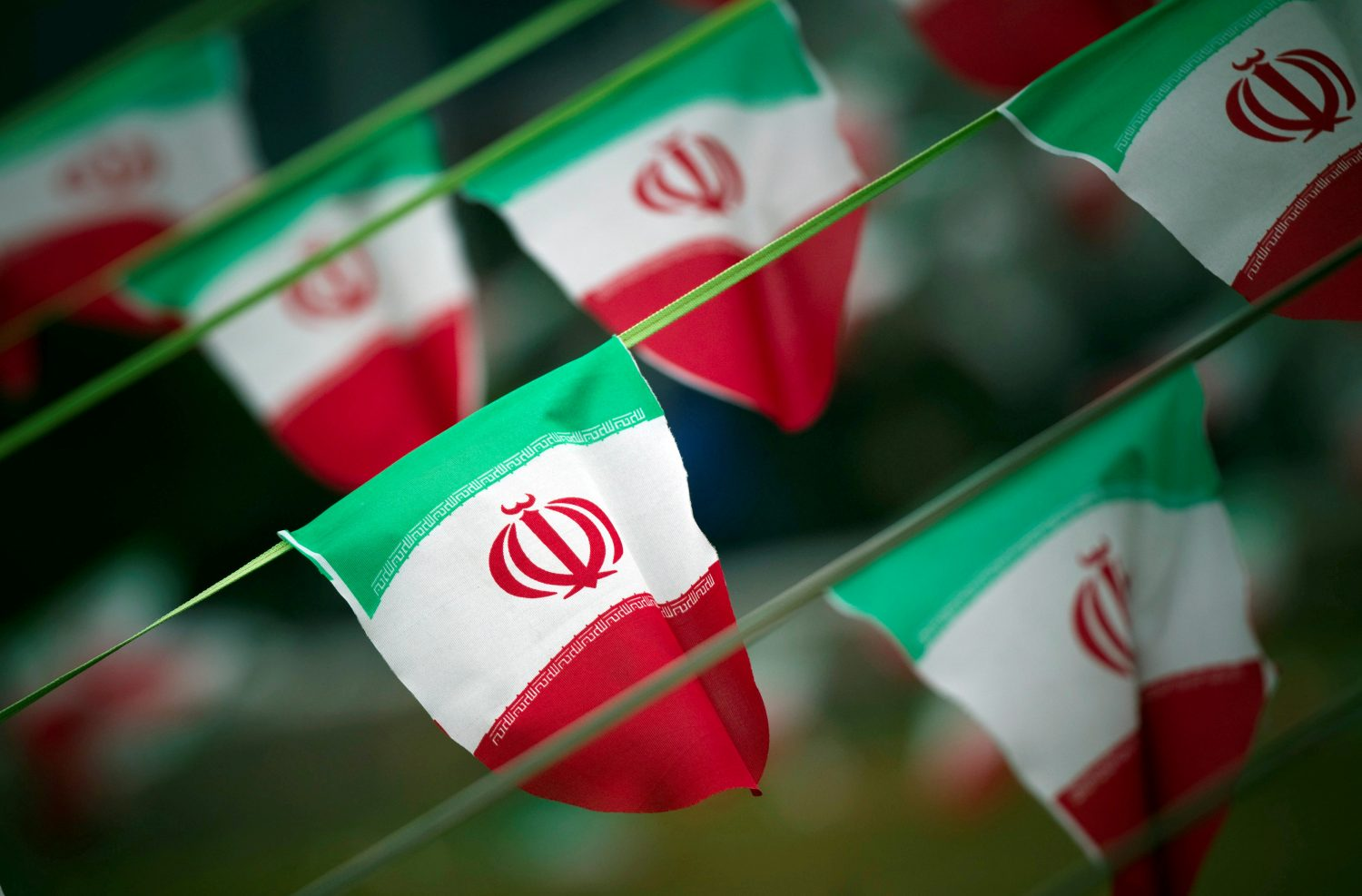 FILE PHOTO: Iran's national flags are seen on a square in Tehran February 10, 2012, a day before the anniversary of the Islamic Revolution. REUTERS/Morteza Nikoubazl