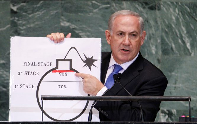 FILE PHOTO: Israel's Prime Minister Benjamin Netanyahu points to a red line he has drawn on the graphic of a bomb as he addresses the 67th United Nations General Assembly at the U.N. Headquarters in New York, U.S., September 27, 2012. REUTERS/Lucas Jackson/File Photo