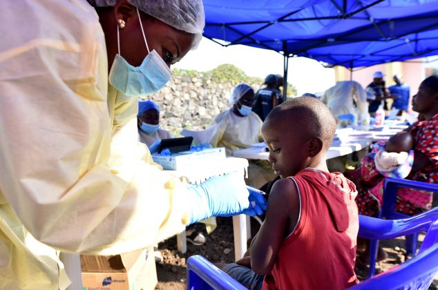 A Congolese health worker administers ebola vaccine to a child at the Himbi Health Centre in Goma, Democratic Republic of Congo, July 17, 2019. REUTERS/Olivia Acland