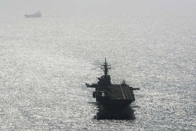 USS Boxer (LHD-4) ship sails near a tanker in the Arabian Sea off Oman July 17, 2019. REUTERS/Ahmed Jadallah