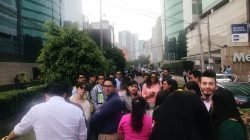 People gather outside the buildings after an earthquake was felt in Mexico City, Mexico July 18, 2019. REUTERS/Henry Romero