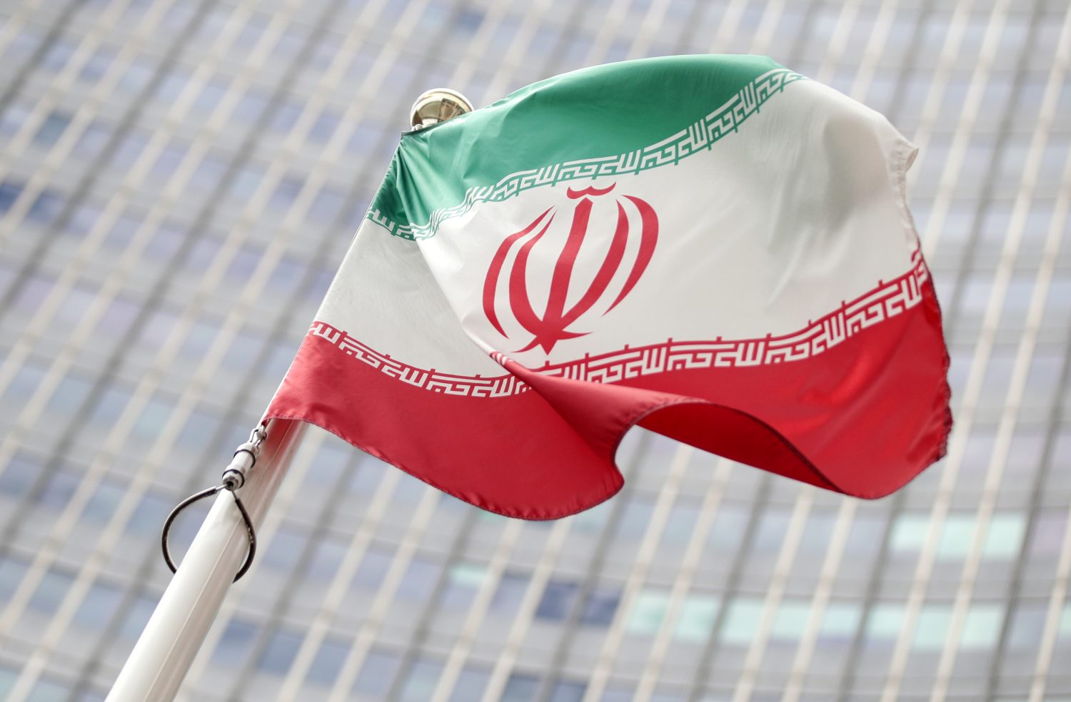 FILE PHOTO - The Iranian flag flutters in front the International Atomic Energy Agency (IAEA) headquarters in Vienna, Austria July 10, 2019. REUTERS/Lisi Niesner