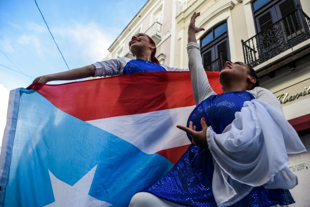 FILE PHOTO - Demonstrators protest for the resignation of Puerto Rico's governor Ricardo Rossello in San Juan, Puerto Rico, July 21, 2019. REUTERS/Gabriella N. Baez