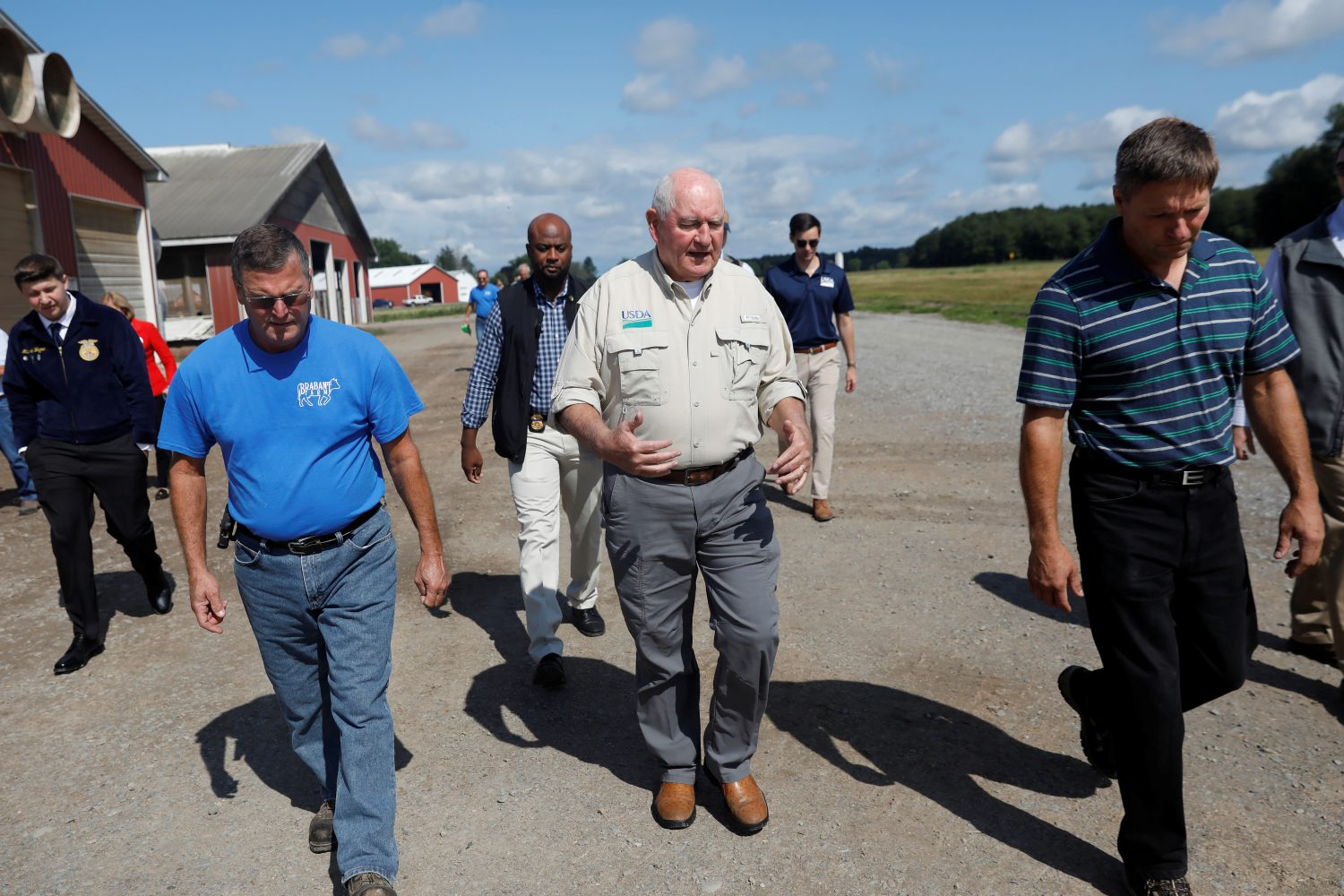 FILE PHOTO: U.S. Agriculture Secretary Sonny Perdue (C) tours the Brabant Farms in Verona, New York, U.S., August 23, 2018. Picture taken August 23, 2018. REUTERS/Shannon Stapleton