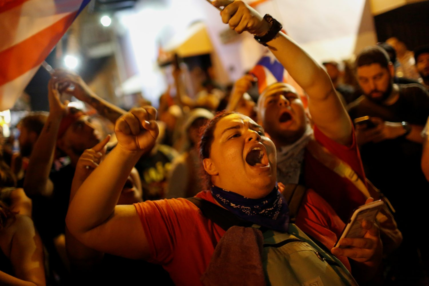 A woman shouts during ongoing protests calling for the resignation of Governor Ricardo Rossello in San Juan, Puerto Rico July 23, 2019. REUTERS/Marco Bello