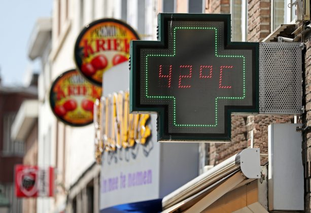 A temperature indicator outside of a pharmacy indicates 42 degres Celsius (107.6 Fahrenheit) in Brussels, Belgium, July 25, 2019. REUTERS/Yves Herman