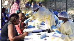 FILE PHOTO: Congolese health workers collect data before administering ebola vaccines to civilians at the Himbi Health Centre in Goma, Democratic Republic of Congo, July 17, 2019. REUTERS/Olivia Acland/File Photo