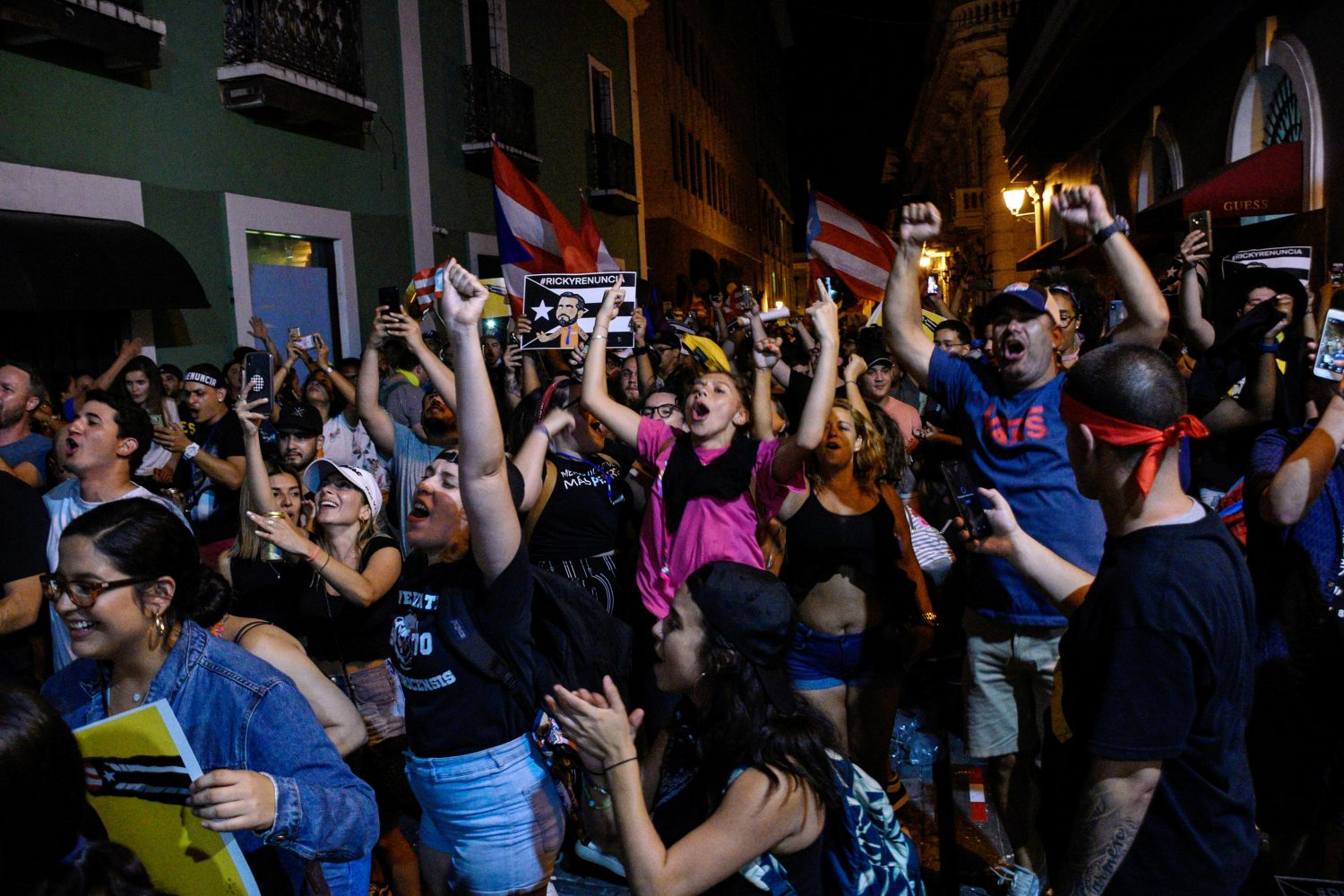 Demonstrators celebrate after the resignation of Puerto Rico Governor Ricardo Rossello in San Juan, Puerto Rico, July 24, 2019. REUTERS/Gabriella N. Baez