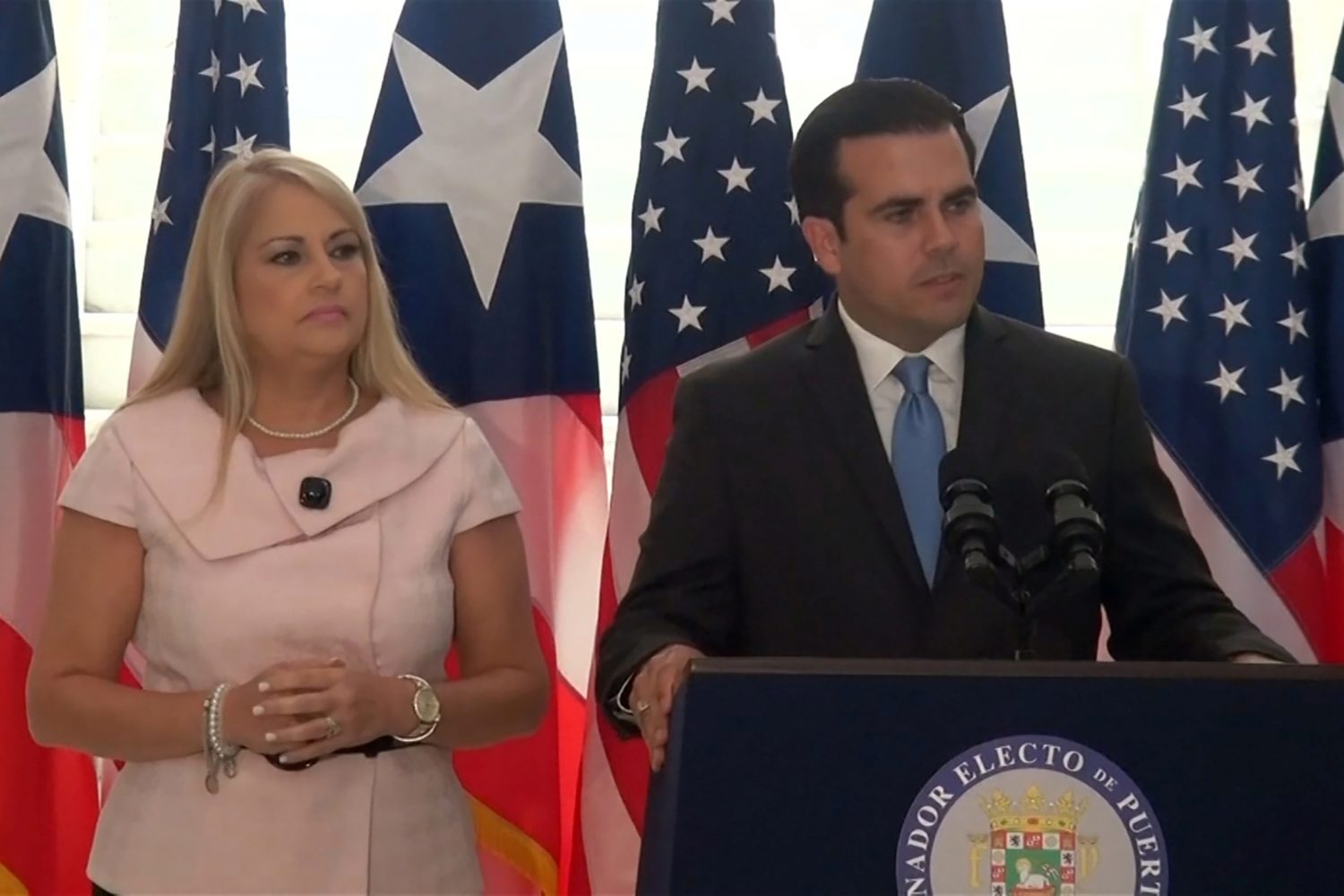 FILE PHOTO: Puerto Rico's Secretary of Justice Wanda Vazquez stands next to Governor Ricardo Rossello during a news conference in an undated still image from file video in San Juan, Puerto Rico. Courtesy WIPR NOTISEIS via REUTERS.
